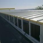 Доставка на покривни панели за надстрояване на съществуващ покрив с метална конструкция и термопанели